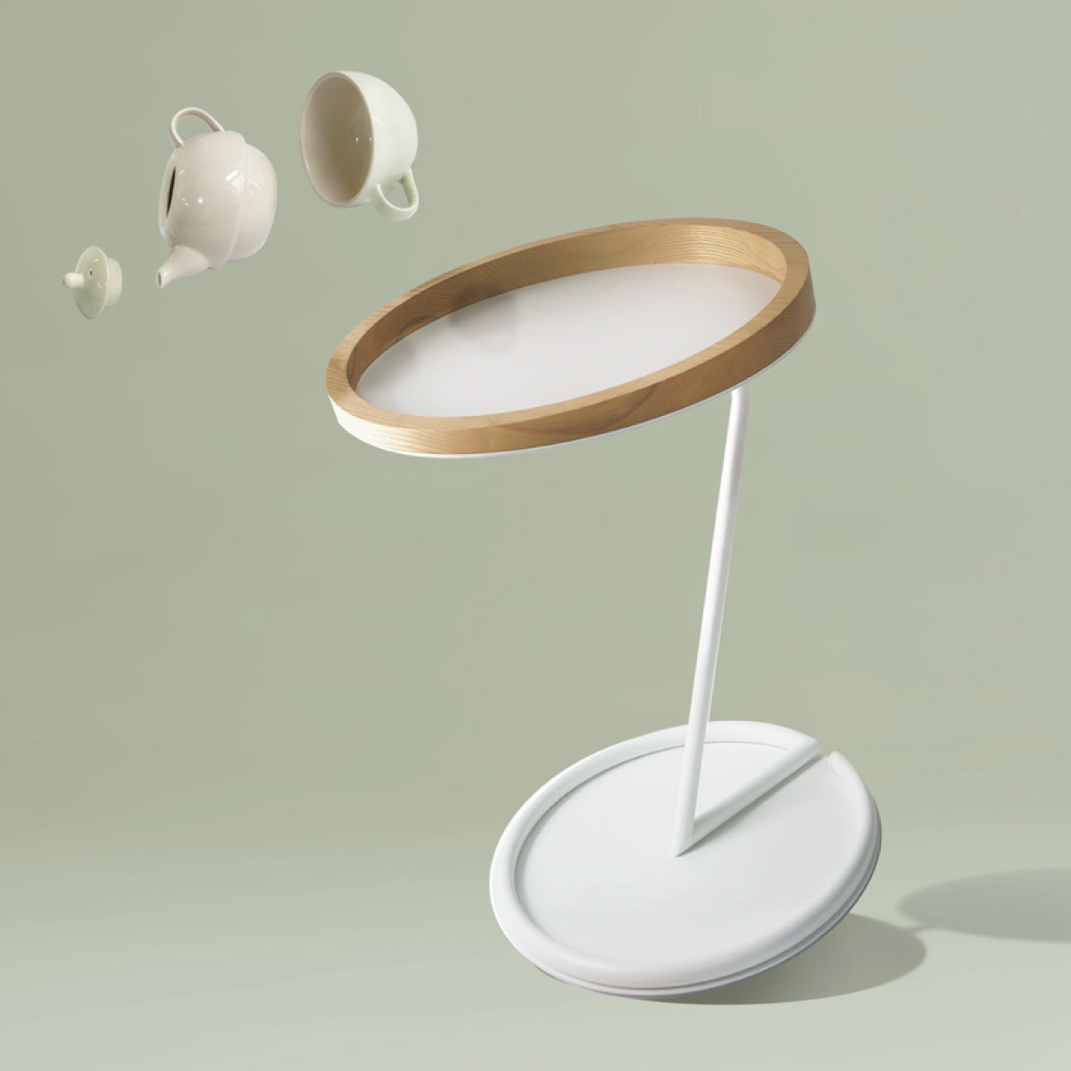 Obelia side table with a teapot and cup falling off the table